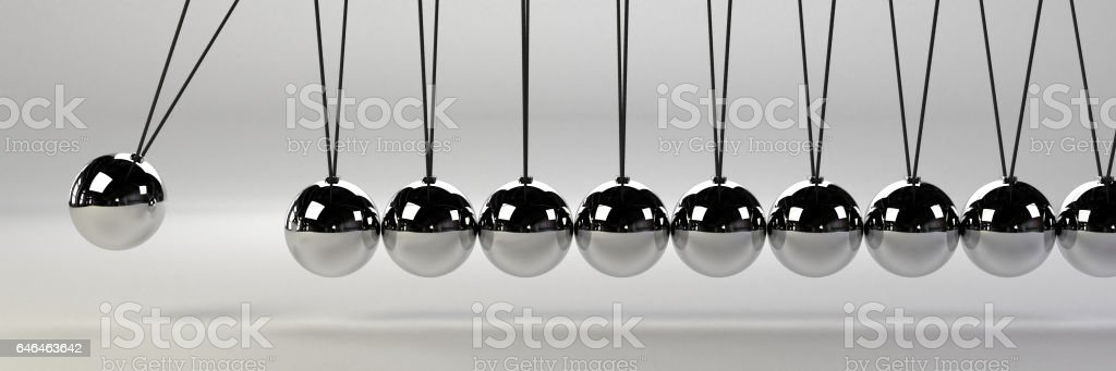 cause and effect concept banner, metal Newton's cradle on a white background stock photo