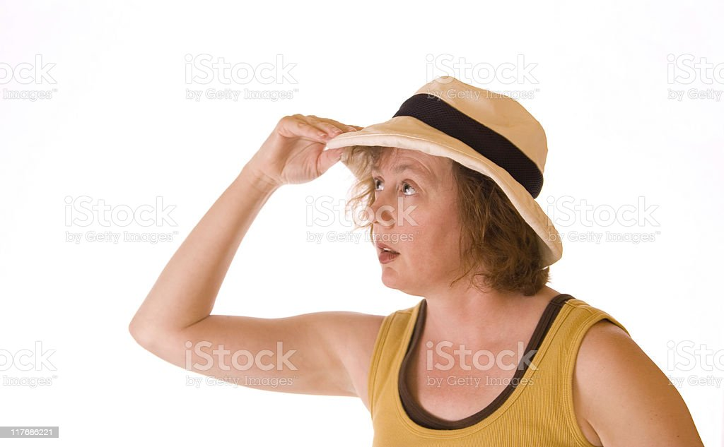 Causian Woman with hand holding her summer hat stock photo
