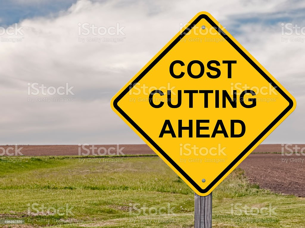 Caution - Cost Cutting Ahead stock photo