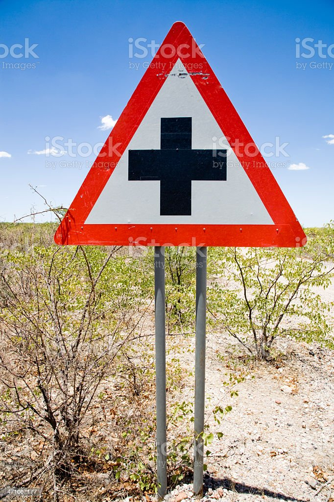 Caution Cross Road Sign royalty-free stock photo