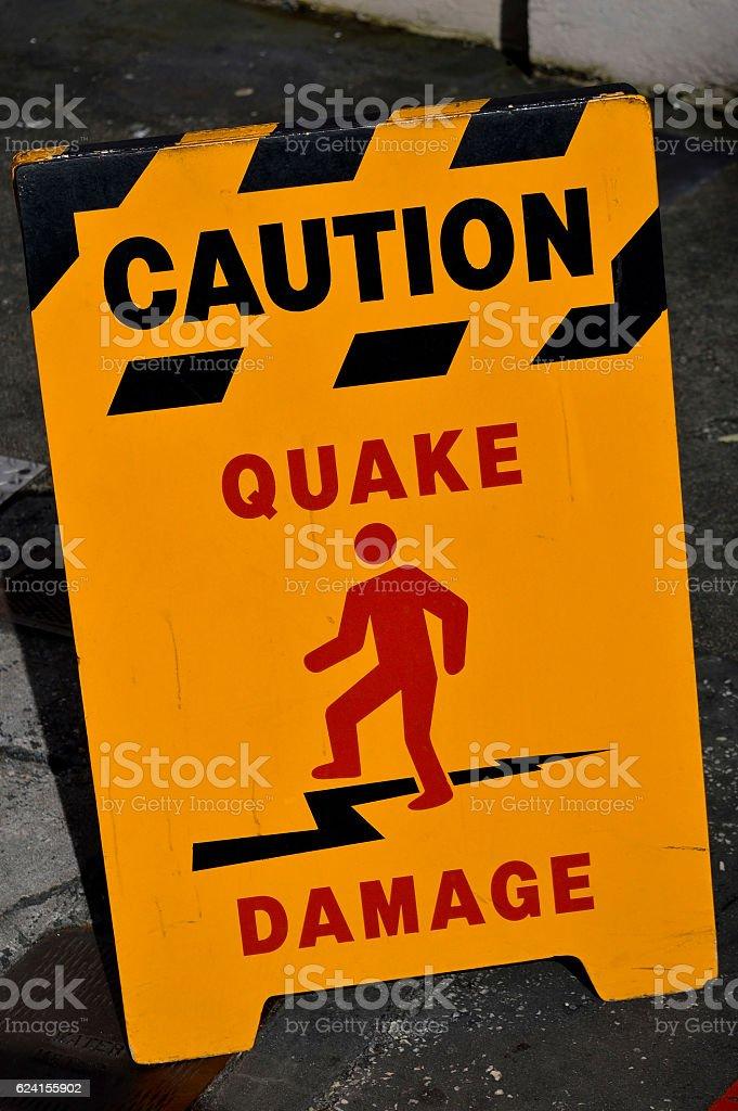 Caution earthquake damage sign stock photo