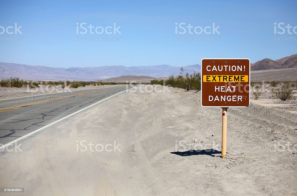 Caution! Extreme Heat Danger sign post stock photo