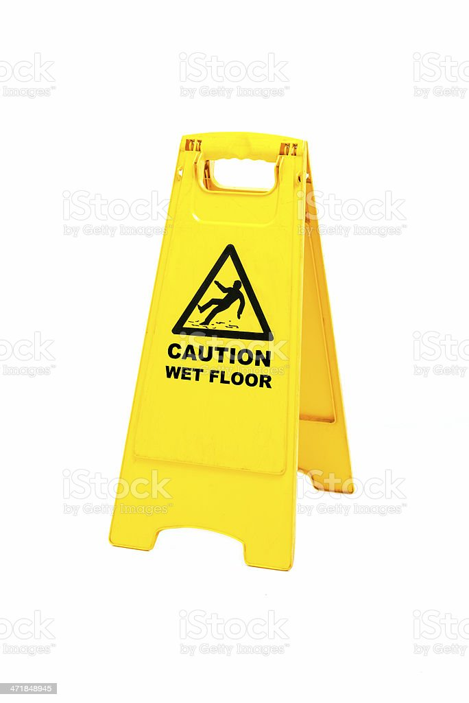 A caution floor sign saying it's wet stock photo
