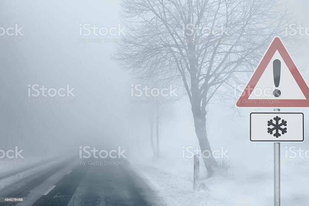 Caution - Foggy Winter Road stock photo