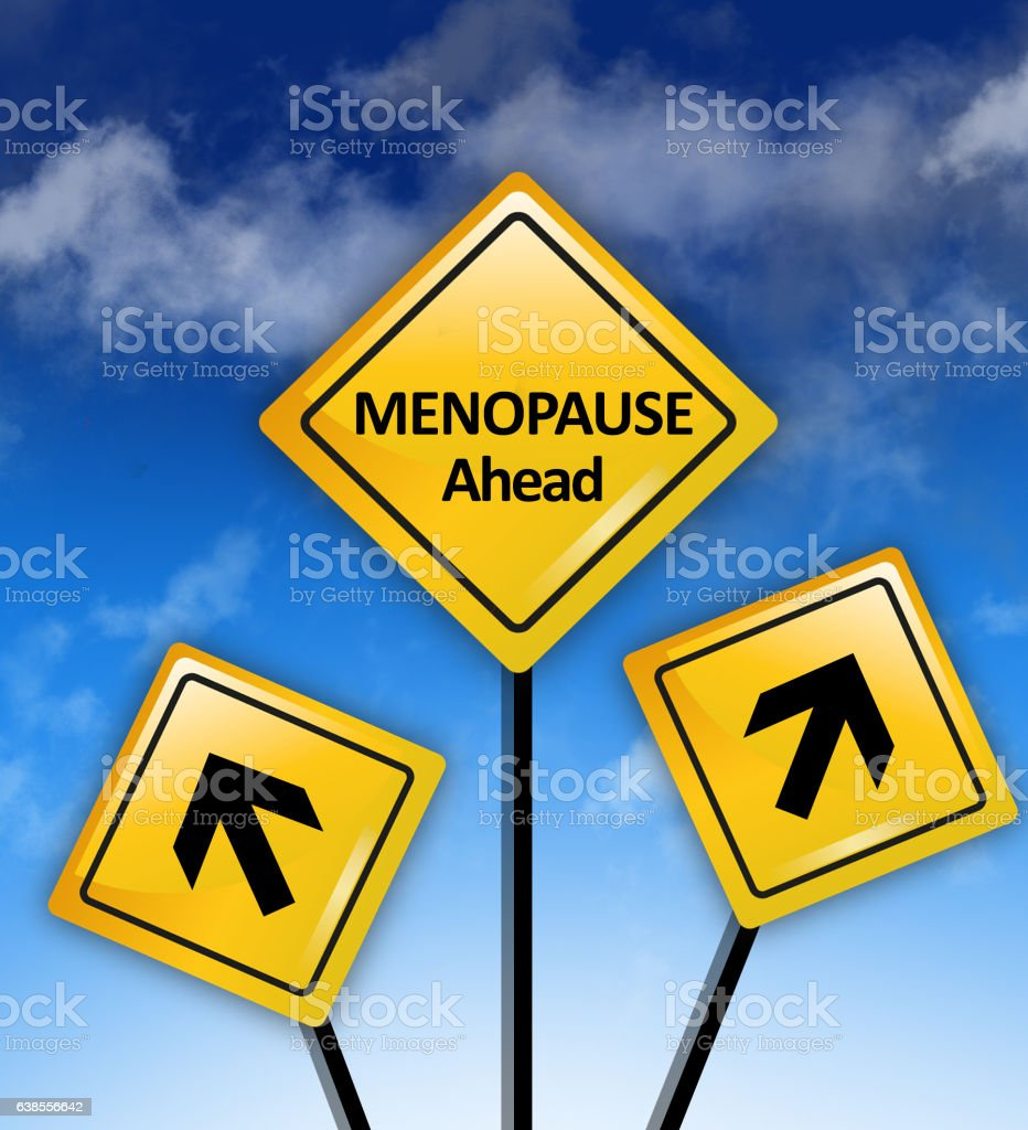 Caution – Menopause ahead text on road sign stock photo