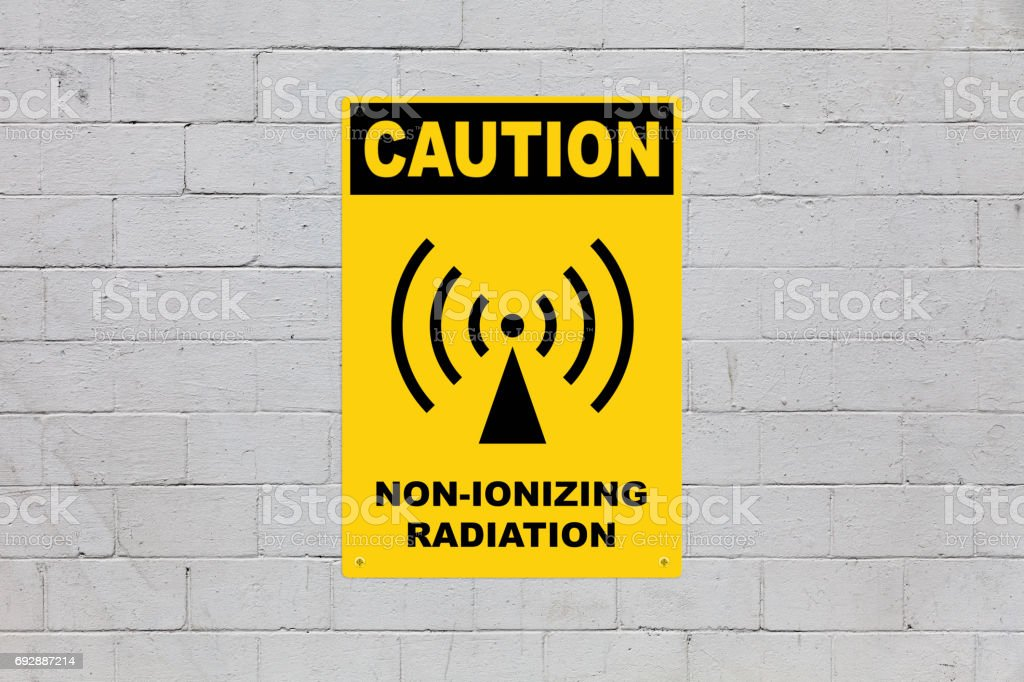 Caution - Non-ionizing radiation stock photo
