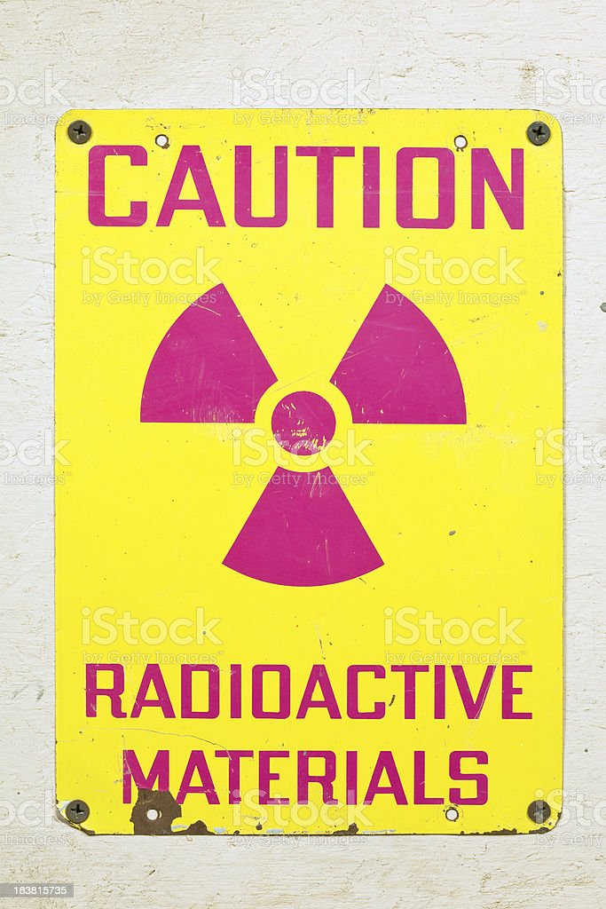 Caution Radioactive Materials Sign on Wood stock photo