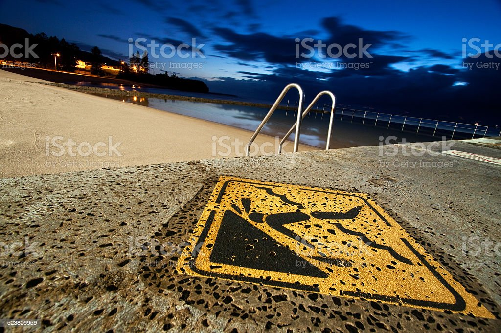 caution shallow water stock photo