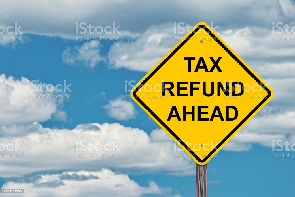 Caution Sign Blue Sky Background - Tax Refund Ahead stock photo