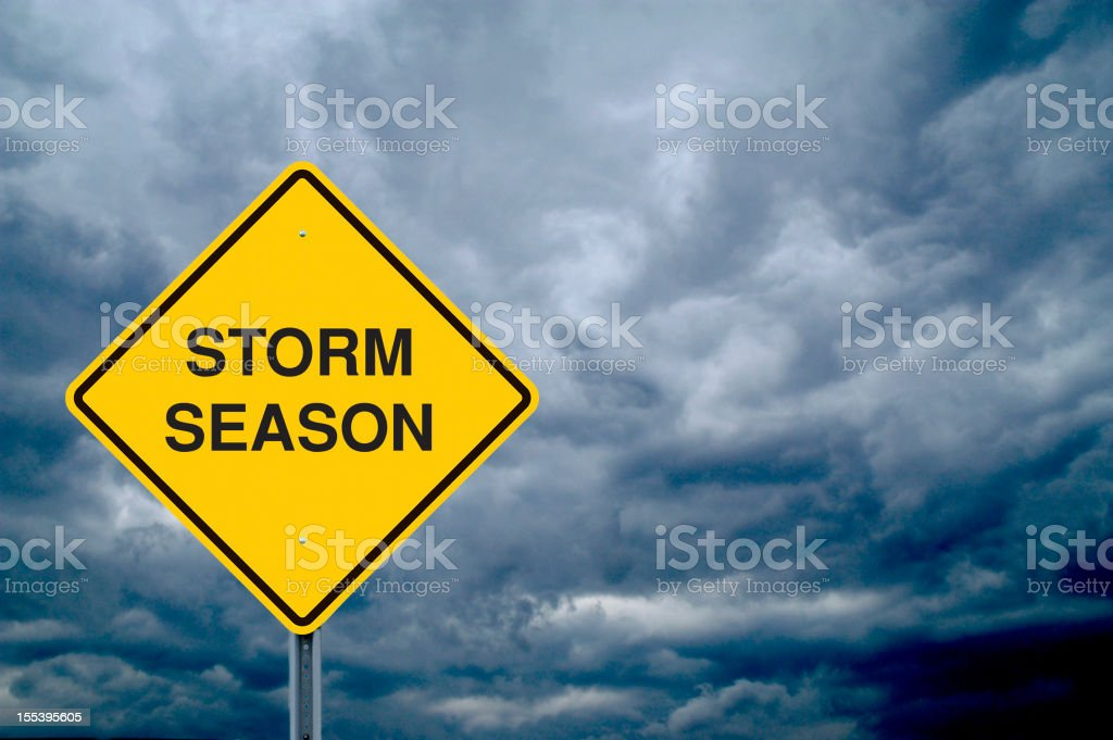 Caution Sign in Front of Storm Clouds royalty-free stock photo