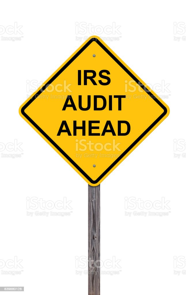 Caution Sign Isolated On White - IRS Audit Ahead stock photo