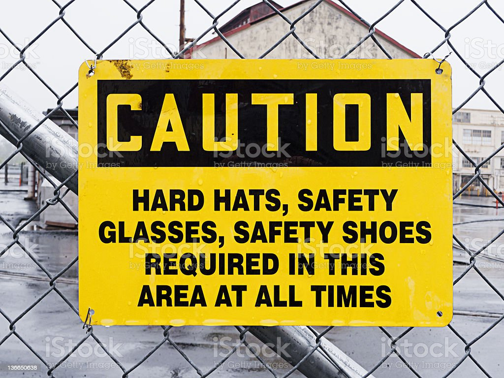 Caution sign outside dangerous industrial site stock photo