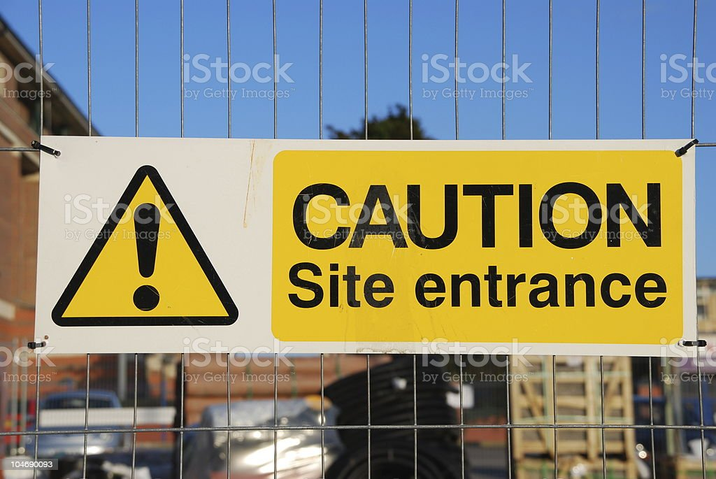 Caution site entrance sign royalty-free stock photo