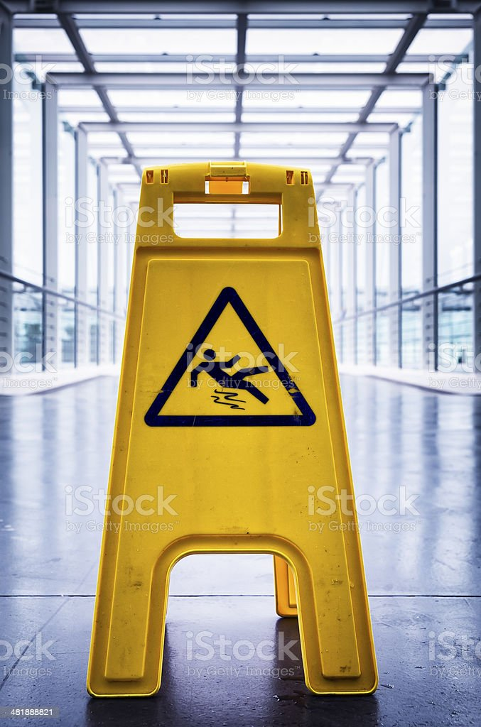 caution slippery surface sign stock photo
