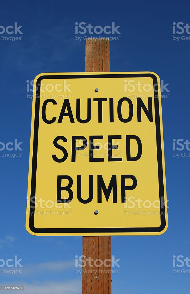 Caution Speed Bump Sign - Vertical stock photo