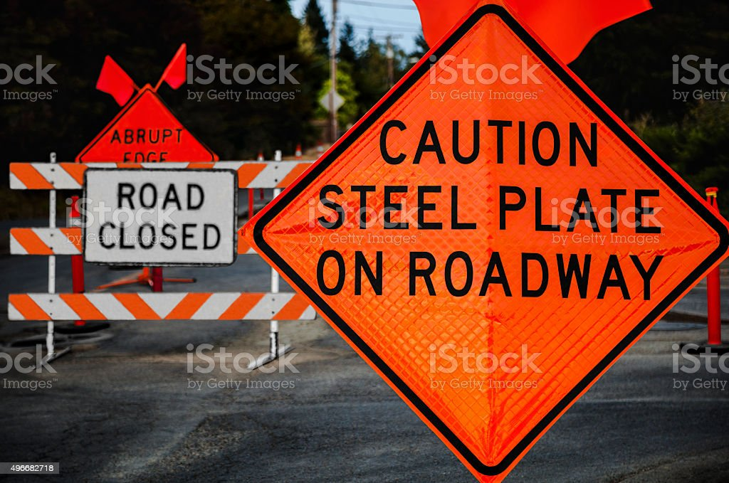 Caution Steel Plate On Roadway stock photo