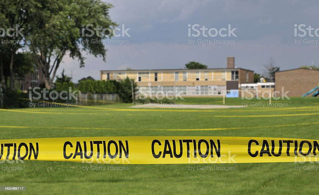 Caution tape at a sports field royalty-free stock photo