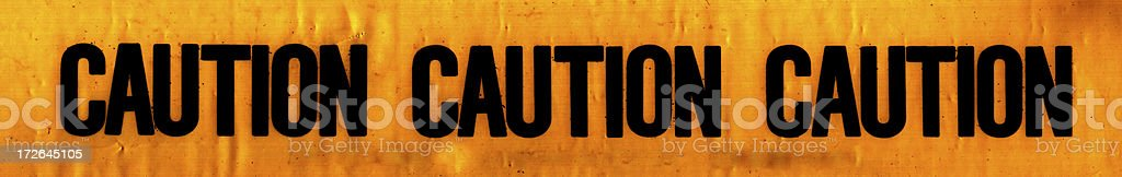 Caution Tape - Grunged royalty-free stock photo