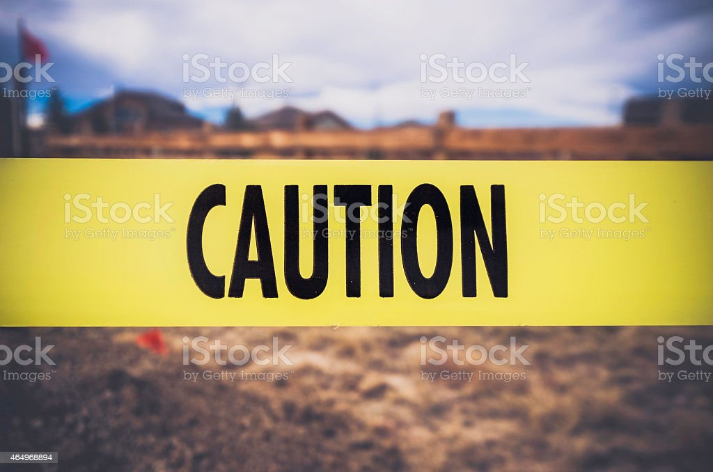 Caution tape in front of excavation. Health and safety concepts. stock photo