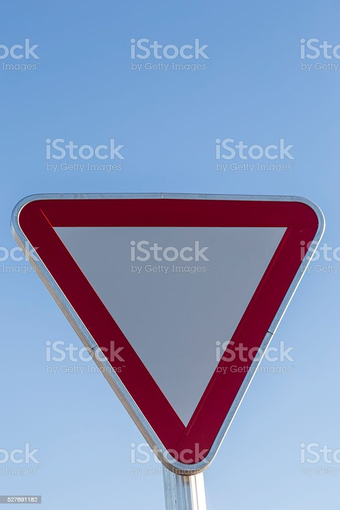 caution traffic signal in red cross and triangle stock photo