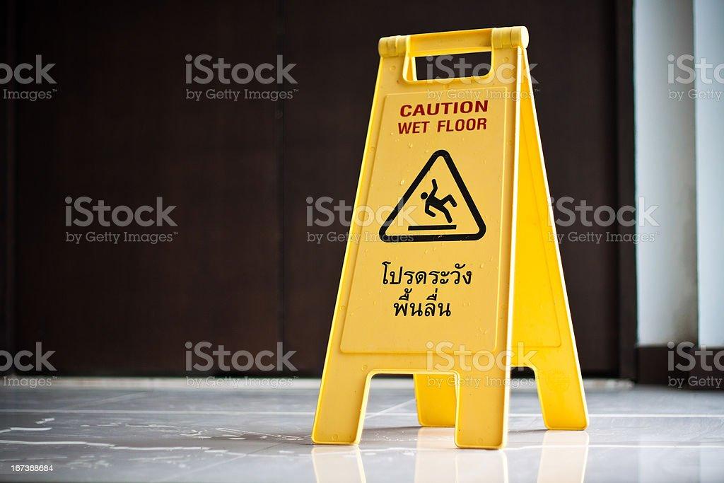 caution wet floor sign stock photo