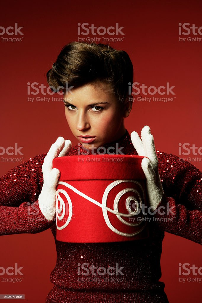 Cautious Woman holding a gift stock photo