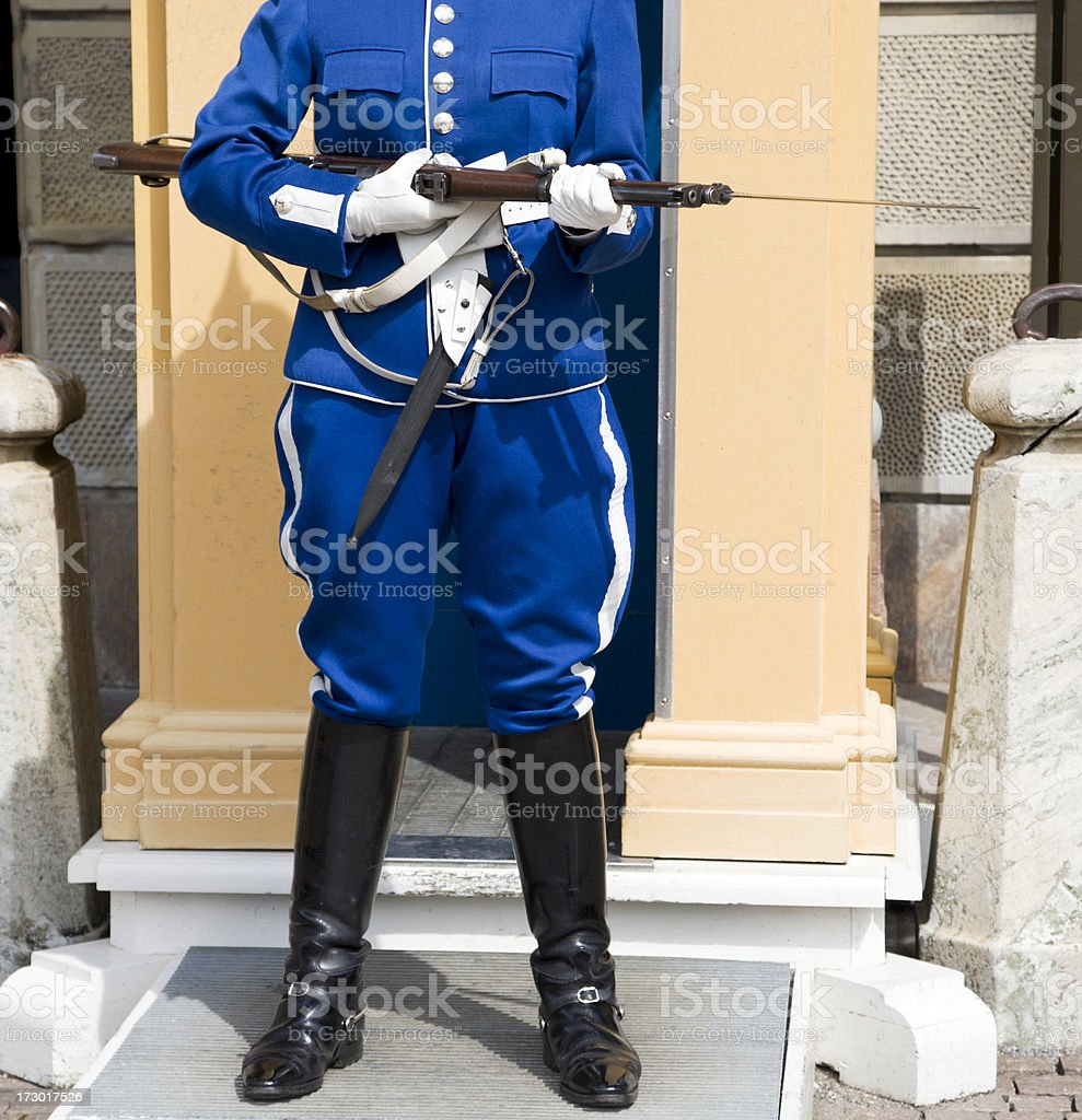 Cavalryman standing guard by Stockholm Royal castle. stock photo