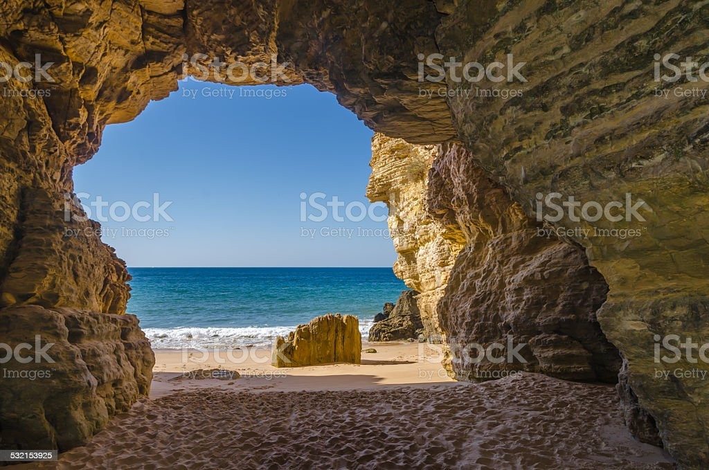Cave at Praia do Beliche stock photo