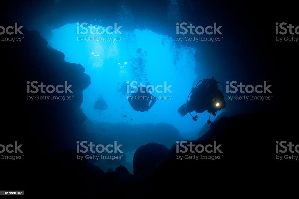 Cave Divers diving into the Santa Maria Caves, Comino, Malta stock photo