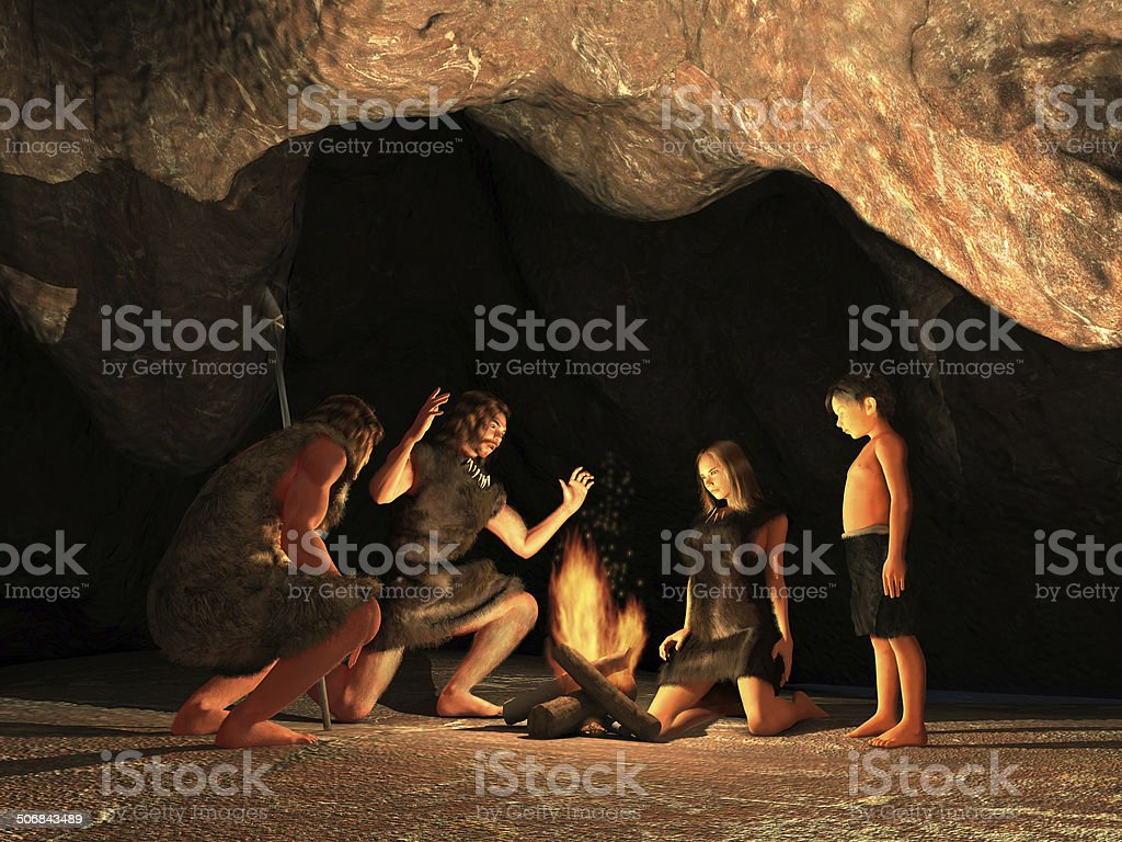 Cave dwellers gathered around a campfire stock photo