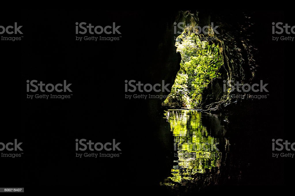 Cave entrance from inside in the tropical jungle. stock photo