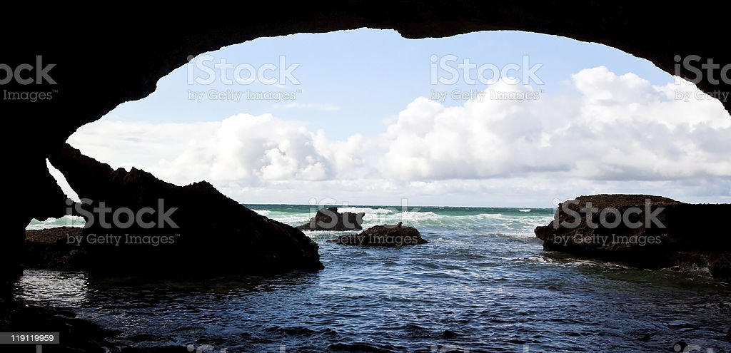 Cave in the ocean stock photo