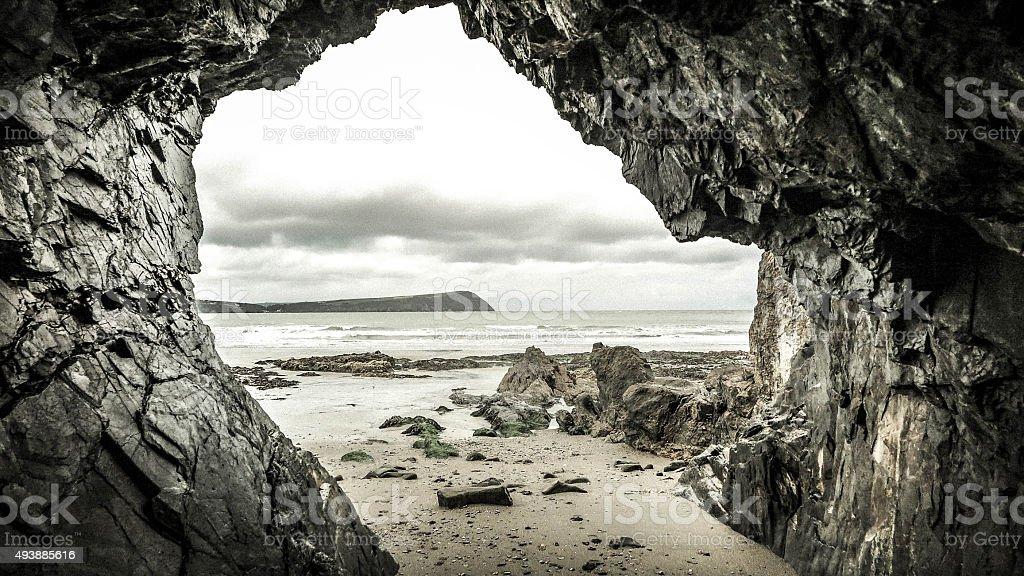 cave on sea shore stock photo
