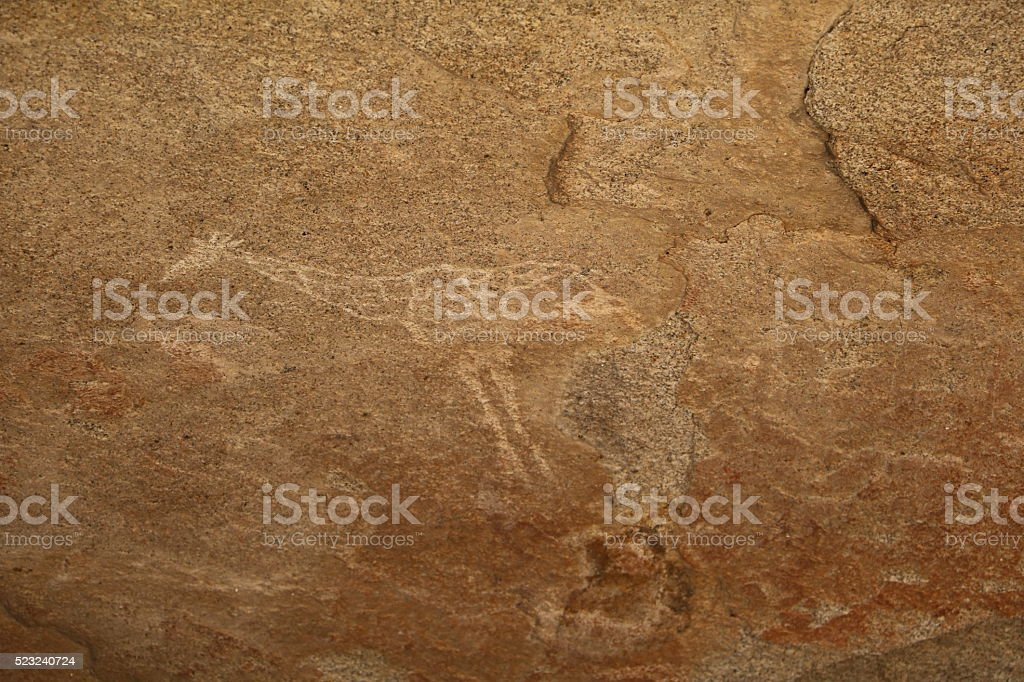 Cave painting giraffe in Phillips Cave, Erongo Mountains Namibia Africa stock photo