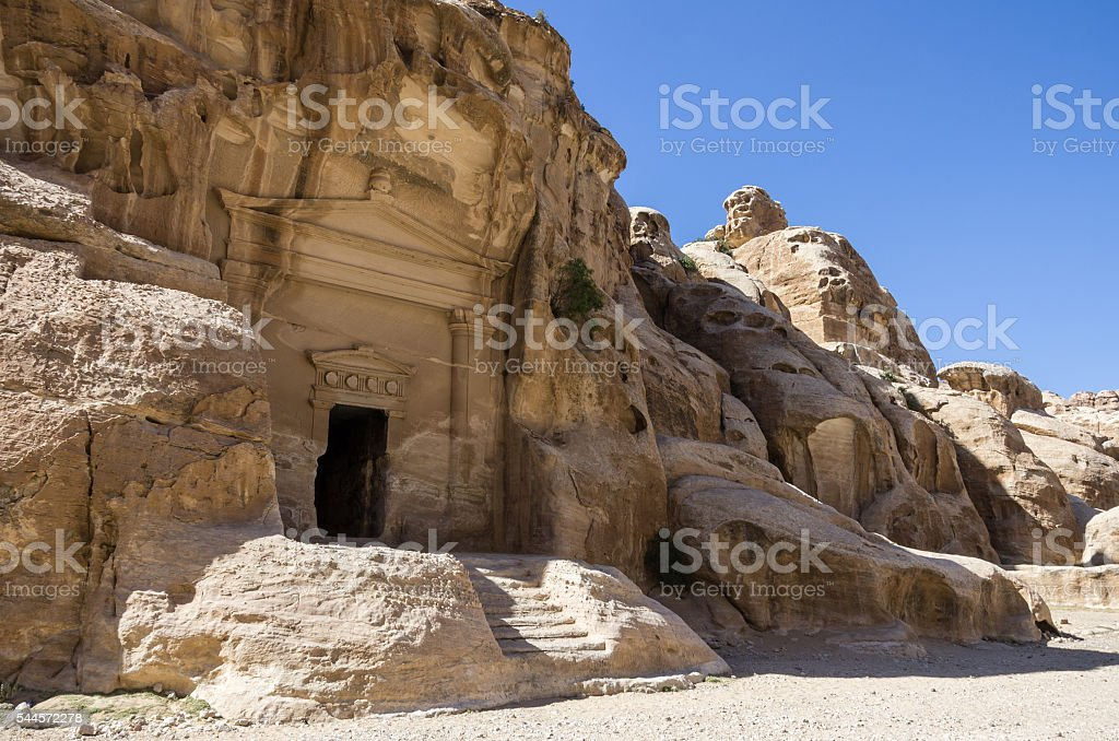 Cave tomb in Nabataean city of the Siq al-Barid stock photo