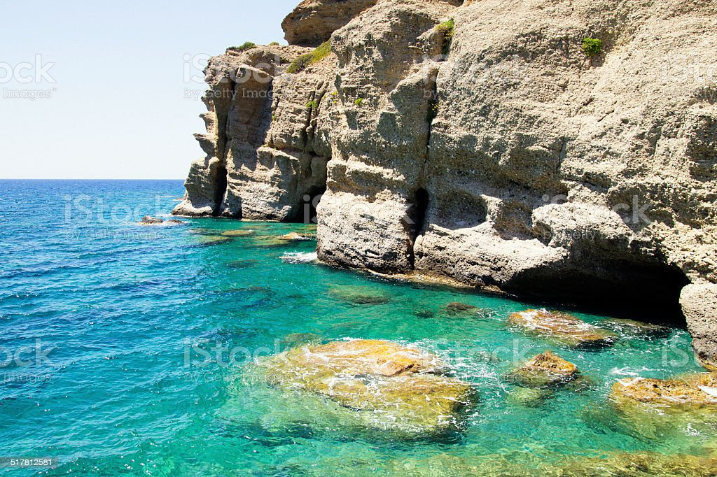 Cave under the water. Seaside Cliff in Agia Galini. stock photo