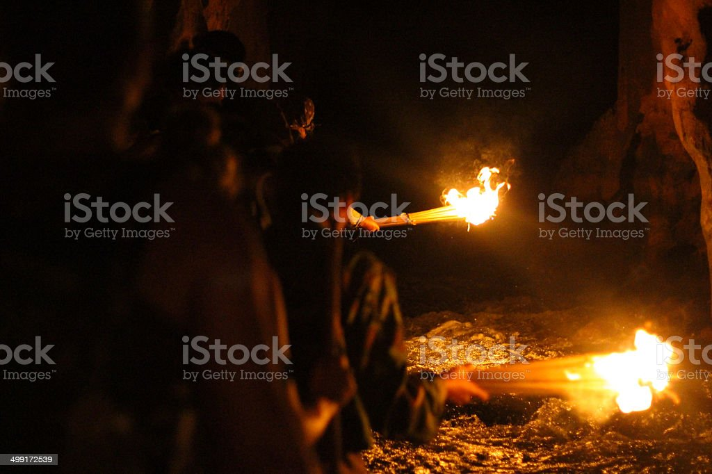 Cave with flaming torches stock photo
