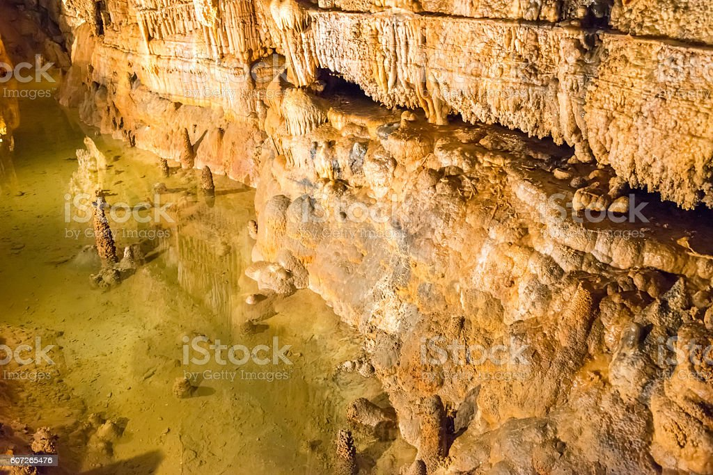 cave with lake in France stock photo