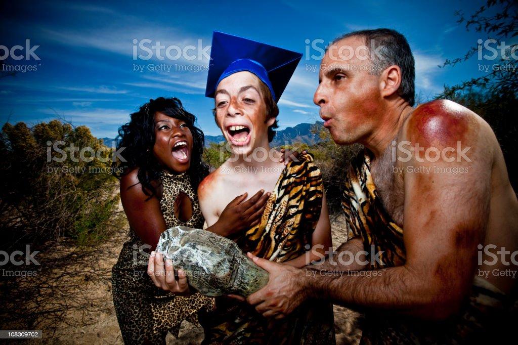 Caveman Graduation stock photo