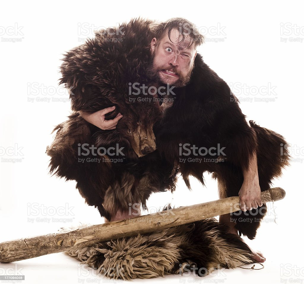 Caveman in bear skin stock photo