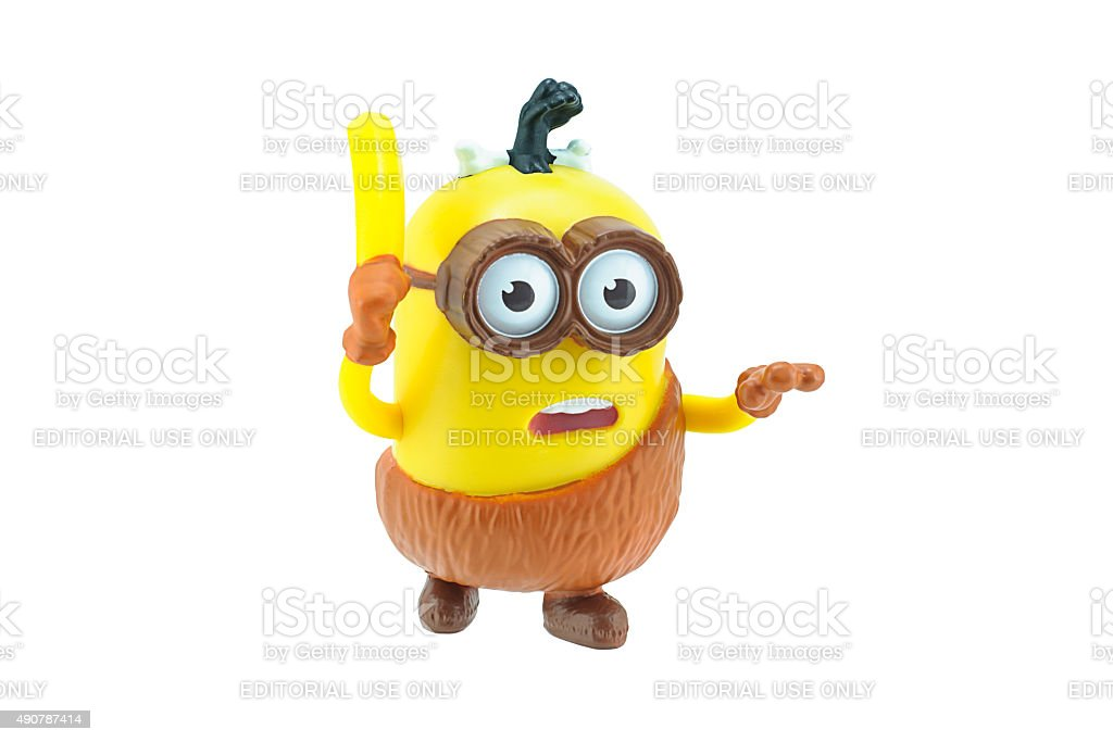 Caveman minions with banana stock photo