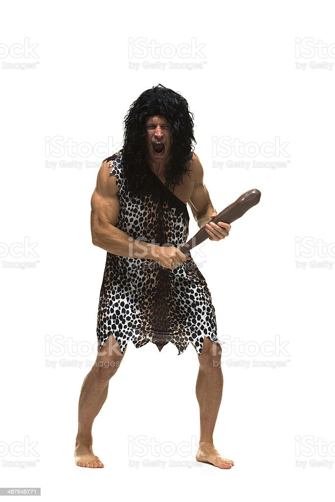 Caveman shouting and holding a club stock photo