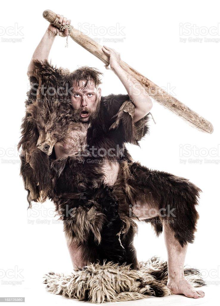 A caveman wearing bearskin a holding a bat stock photo