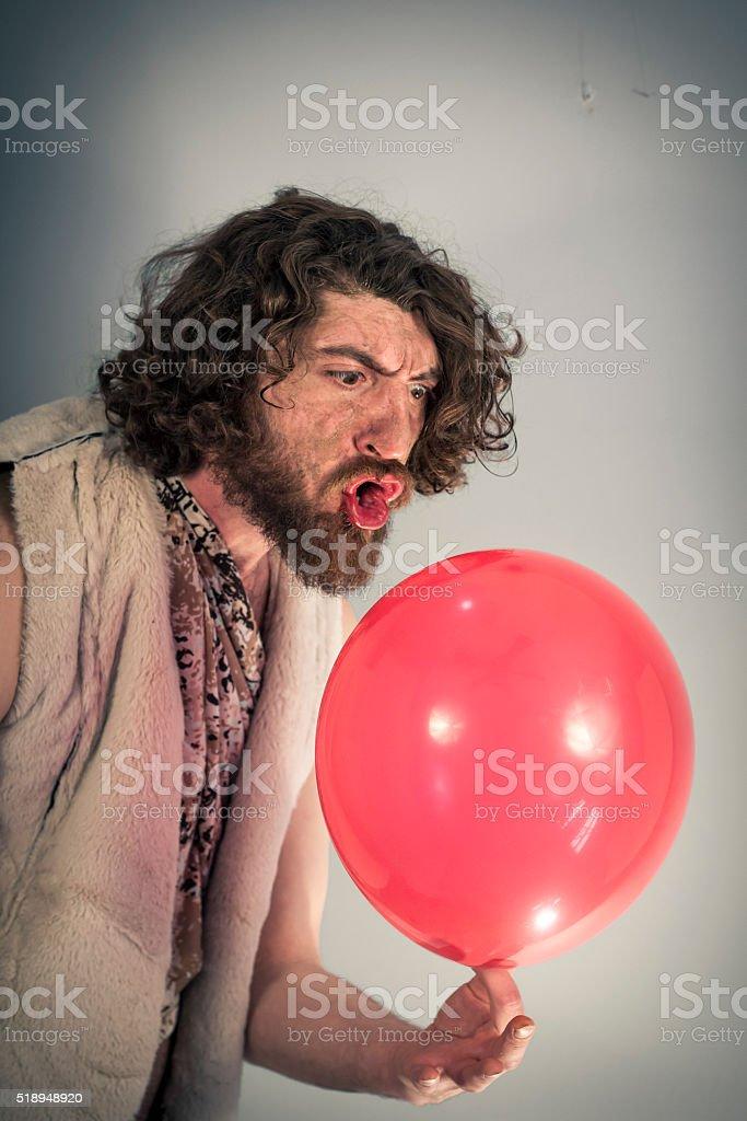 Caveman Yelling Balloon stock photo