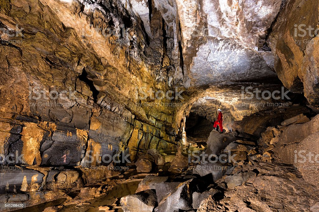 Caver Posing in the Beautiful Colorful Cave stock photo