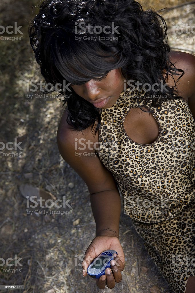 Cavewoman Checking Blood Glucose Level On Glucometer royalty-free stock photo