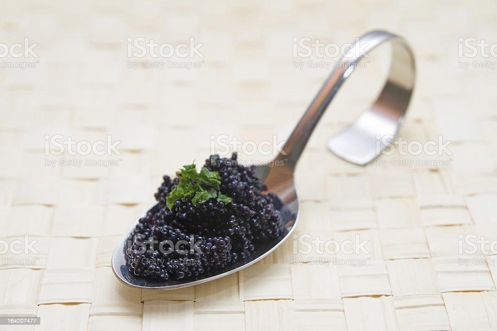 Caviar on a spoon stock photo