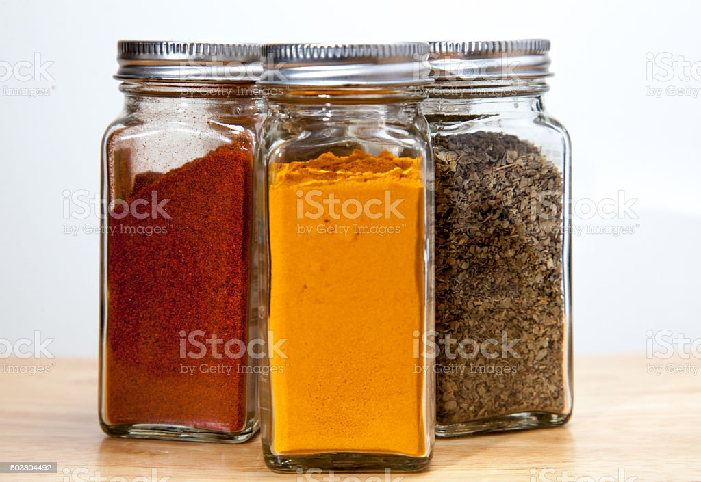 Cayenne Turmeric & Coriander Spice Jars stock photo