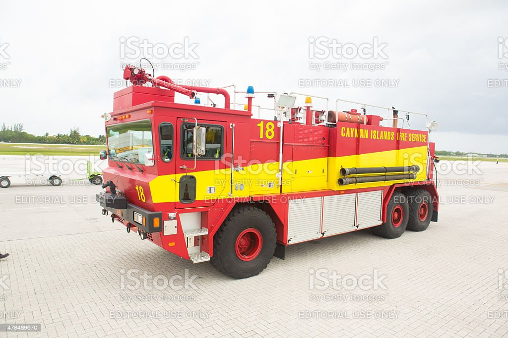 Cayman Island firetruck sitting on the tarmac at airport stock photo