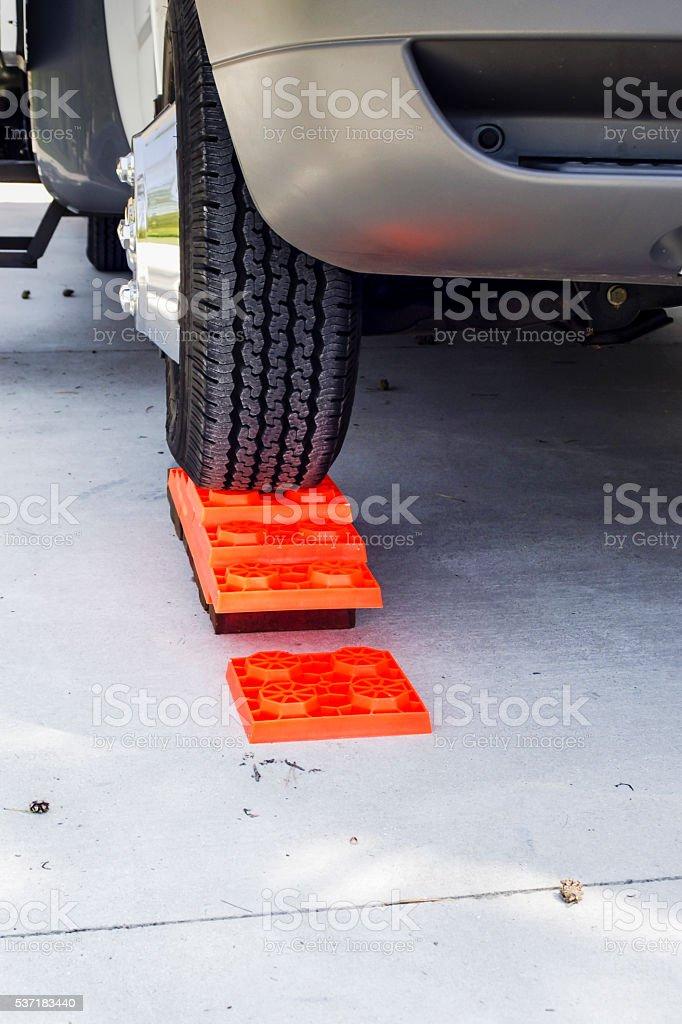 C-Class Motorhome on levelling blocks stock photo